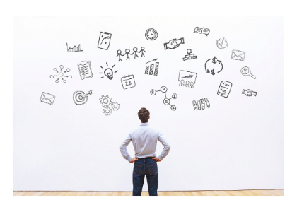 man in suit staring at wall with multiple abstract icons on it