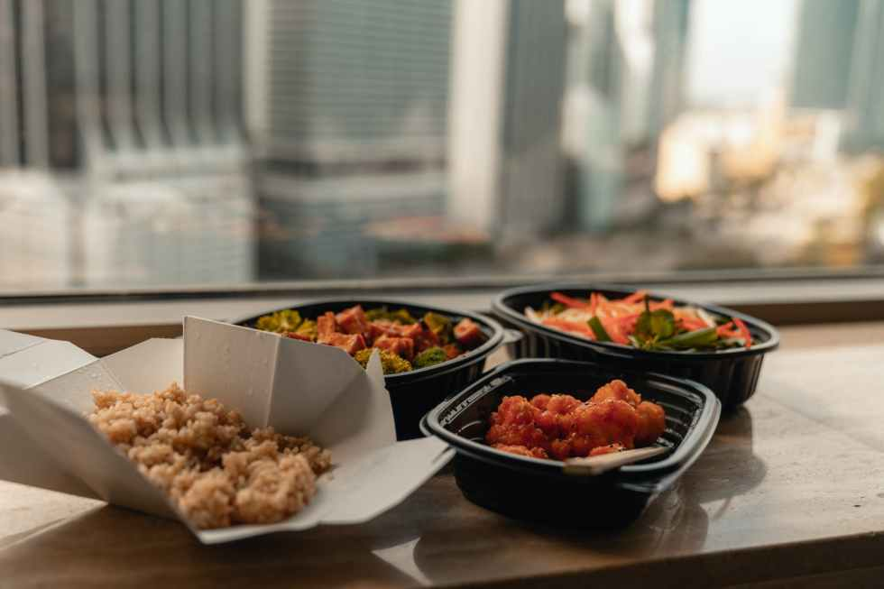 takeaway meals in container on a windowsill