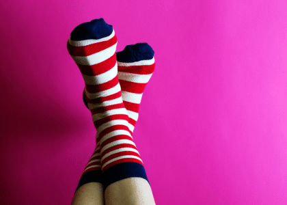 feet with red and white striped socks