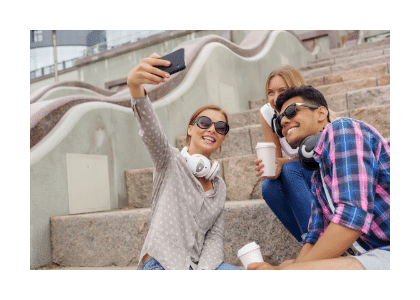 three young adults sitting on stairs with coffee in the hands whilst posing for a selfie