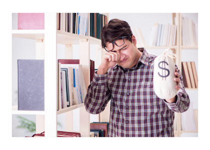 man holding bag of money near a bookshelf