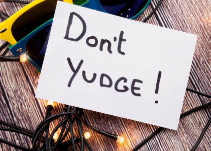piece of paper with ''don't yudge'' written on it