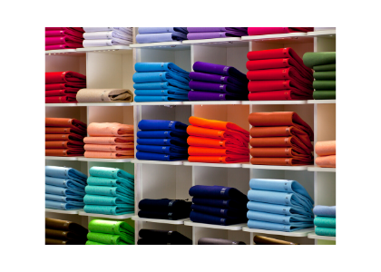 Cupboard squares displaying multi colored scarves on shelves