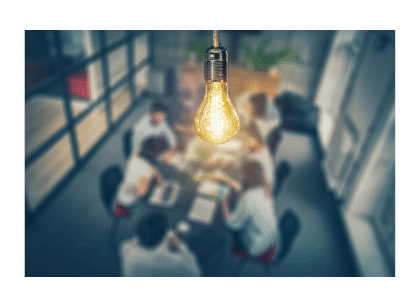 boardroom meeting with lightbulb
