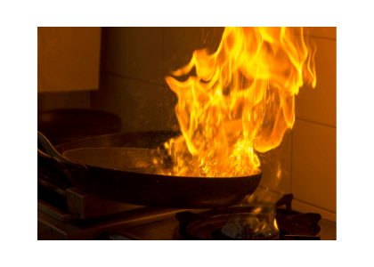 flambe being cooked in flames