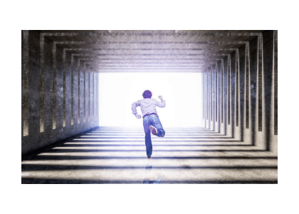 man running through a tunnel