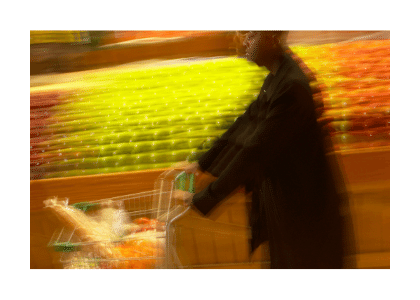 person in motion grocery shopping